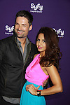 "Alphas' Warren Christie & Azita Ghanizada (on General Hospital Night Shirft ""Dr. Saira Batra"") at the Syfy Upfront 2012 on April 24, 2012 at the American Museum of Natural History, New York City  (Photo by Sue Coflin/Max Photos)"