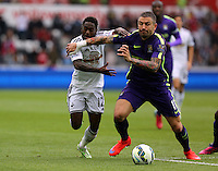 SWANSEA, WALES - MAY 17: (L-R) Nathan Dyer of Swansea is challenged by Aleksandar Kolarov of Manchester City during the Premier League match between Swansea City and Manchester City at The Liberty Stadium on May 17, 2015 in Swansea, Wales. (photo by Athena Pictures/Getty Images)