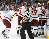 Barry Almeida (BC - 9), Patrick Wey (BC - 6), Patrick Brown (BC - 23), Bill Arnold (BC - 24) and Philip Samuelsson (BC - 5) celebrate Samuelsson's goal. - The Boston College Eagles defeated the Boston University Terriers 3-2 (OT) in their Beanpot opener on Monday, February 7, 2011, at TD Garden in Boston, Massachusetts.