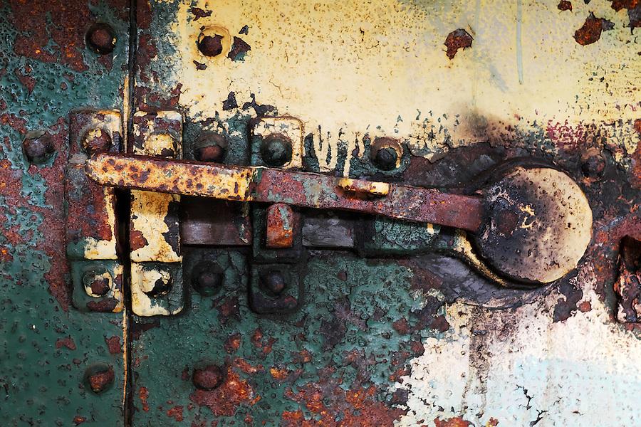Rusty steel latch on steel bunker tunnel door, Artillery Hill, Fort Worden State Park, Port Townsend, Washington, USA