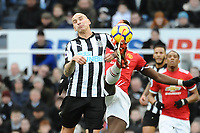 Jonjo Shelvey of Newcastle United battles with Paul Pogba of Manchester United during Newcastle United vs Manchester United, Premier League Football at St. James' Park on 11th February 2018