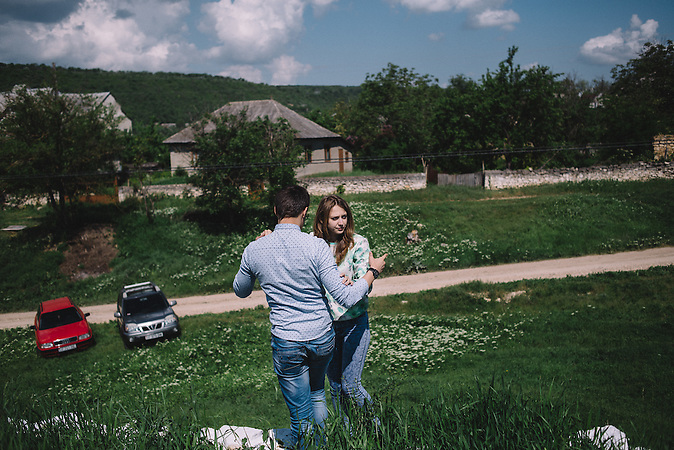 Alexander and Katrine aproaching the cemetery in Ghidirim village during Easter for Dead