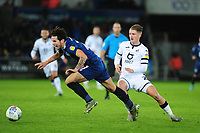Lewis Travis of Blackburn Rovers battles with George Byers of Swansea City during the Sky Bet Championship match between Swansea City and Blackburn Rovers at the Liberty Stadium in Swansea, Wales, UK. Wednesday 11 December 2019