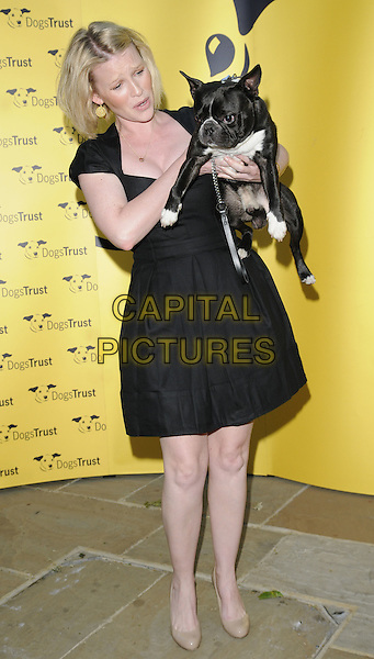 JOANNA PAGE.The Dogs Trust Honours Awards 2010, Jasmine Studios, Shepherd's Bush, London, England..June 3rd, 2010.full length black dress beige shoes dog animal pet lifting carrying funny .CAP/CAN.©Can Nguyen/Capital Pictures.
