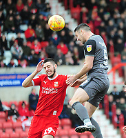 Lincoln City's Jason Shackell gets above Swindon Town's Canice Carroll<br /> <br /> Photographer Andrew Vaughan/CameraSport<br /> <br /> The EFL Sky Bet League Two - Swindon Town v Lincoln City - Saturday 12th January 2019 - County Ground - Swindon<br /> <br /> World Copyright &copy; 2019 CameraSport. All rights reserved. 43 Linden Ave. Countesthorpe. Leicester. England. LE8 5PG - Tel: +44 (0) 116 277 4147 - admin@camerasport.com - www.camerasport.com