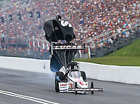 Jun 20, 2015; Bristol, TN, USA; NHRA top fuel driver Richie Crampton during qualifying for the Thunder Valley Nationals at Bristol Dragway. Mandatory Credit: Mark J. Rebilas-