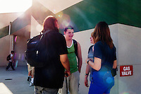 Lindsay, California, September 5, 2012 - Students gather before class begins at Lindsay High School. ..The school began building a competency-based education model about 7 years ago, fully implementing it just over three years ago and is set to graduate its first class this school year. This model does away with traditional grading and pass/fail for grades. Instead students are expected to achieve proficiency in a range of areas in each class, where a 3 (equal to a traditional B) is passing; A 4 is considered intensive and usually denotes college bound. Says Principal Jaime Robles, ?This allows students to learn at there own pace. If a student is advanced, they can move ahead, and if a student is lagging, they get the support they need.? Part of this model allows for students who are more advanced dig deeper and push harder and truly move ahead of others. Because they are ahead, some spend the extra time learning more, others take concurrent classes at the nearby community college and some choose to graduate early to start their path. ?Each student has their own set of goals,? says English teacher Amalia Lopez, ?Whatever their goals are, we support them.?.Slug: DD_ CompetencyByline: Daryl Peveto / LUCEO for Education Week