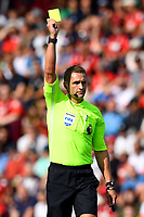 Referee Craig Pawson   gives a yellow card to Wes Morgan of Leicester City during AFC Bournemouth vs Leicester City, Premier League Football at the Vitality Stadium on 15th September 2018