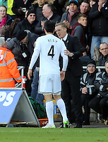 SWANSEA, WALES - FEBRUARY 21: Ki Sung Yueng of Swansea is spoken to by his manager Garry Monk after scoring his equaliser during the Barclays Premier League match between Swansea City and Manchester United at Liberty Stadium on February 21, 2015 in Swansea, Wales.