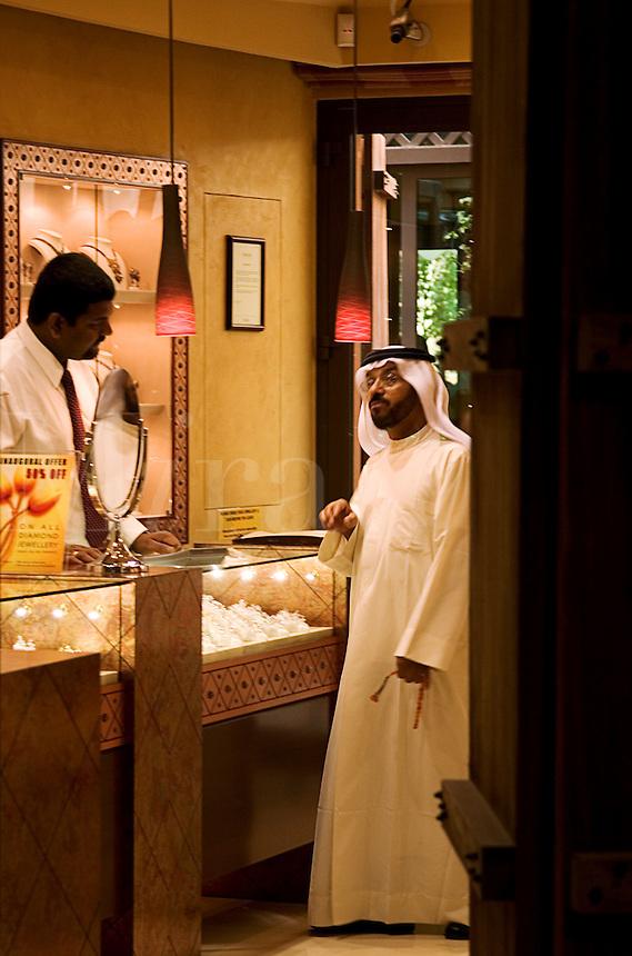 Dubai, United Arab Emirates. Arab man in jeweller's shopin.Souk at Madinat Jumeirah/Jumeira.
