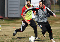 WASHINGTON, DC - NOVEMBER 14, 2012: Ben Olsen of DC United moves the ball in front of Daniel Woolard (21) during a practice session before the second leg of the Eastern Conference Championship at DC United practice field, in Washington, DC on November 14.