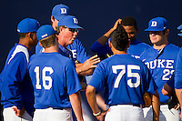 Duke Blue Devils assistant coach Sean Snedeker #33 talks to his pitching staff prior to the game against the Virginia Cavaliers at Durham Bulls Athletic Park on April 20, 2012 in Durham, North Carolina.  The Blue Devils defeated the Cavaliers 6-3.  (Brian Westerholt/Four Seam Images)