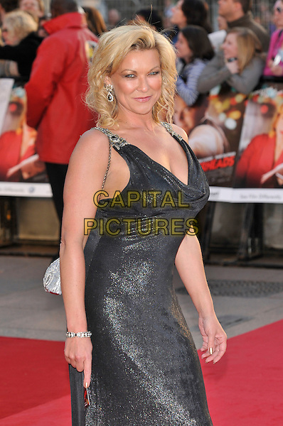 "CLAIRE KING.Attending the ""Leatherheads"" European Film Premiere  held at the Odeon cinema, Leicester Square London, England, 8th April 2008..half length 3/4 black tights shiny dress cleavage low cut white silver bag.CAP/PL.©Phil Loftus/Capital Pictures..."