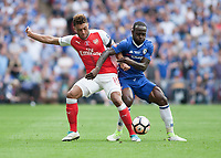 Alex Oxlade-Chamberlain of Arsenal battles with Victor Moses of Chelsea during the FA Cup Final match between Arsenal v Chelsea, Wembley stadium, London on 27th May 2017