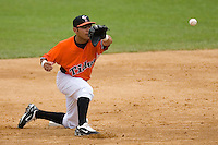Shortstop Carlos Rojas #12 of the Norfolk Tides waits for a throw at second base at Harbor Park June 7, 2009 in Norfolk, Virginia. (Photo by Brian Westerholt / Four Seam Images)