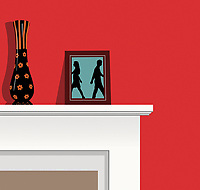 Couple walking away from each other in photograph on mantelpiece