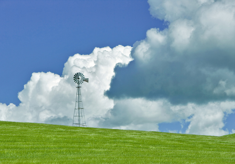 Windmill in wheat field. with clouds. The Palouse, Washington