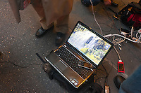 New York, NY -  31October 2012 Residents of Lower Manhattan charge cell phones and laptop computers from a single maintenance outlet at 600 Third Avenue, half a block north of the Blackout Zone. Powerstrips were piggy-backed onto powerstrips and iPhones were piggy-backed onto laptops to allow more than 15 devices to charge at a time.