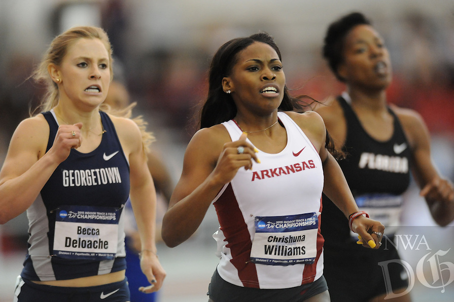NWA Democrat-Gazette/ANDY SHUPE - Chrishuna Williams (center) of Arkansas leads Sabrina Southerland of Georgetown (left) and Claudia Francis of Florida in the 800 meters Friday, March 13, 2015, during the NCAA Indoor Track and Field Championship at the Randal Tyson Track Center in Fayetteville.