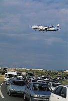 Airplane flying over a traffic jam near Marignane Airport, Berre, Provence, France.