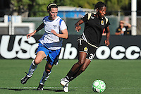 19 July 2009: Formiga of the FC Gold Pride drives the ball upfield closely followed by Kelly Schmedes of the Boston Breakers during the game at Buck Shaw Stadium in Santa Clara, California.  The Boston Breakers defeated the FC Gold Pride, 1-0.