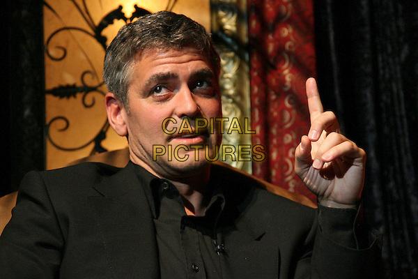 GEORGE CLOONEY.The Modern Master Award honoring George Clooney - Show held at the Arlington Theatre, Santa Barbara, California, USA..February 3rd, 2006.Photo: Zach Lipp/AdMedia/Capital Pictures.Ref: ZL/ADM.headshot portrait finger pointing.www.capitalpictures.com.sales@capitalpictures.com.© Capital Pictures.