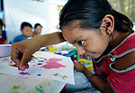 A girl creates art during a session of the early intervention program of Piña Palmera, a center for community based rehabilitation for people living with disabilities in Zipolite, a town in Oaxaca, Mexico.