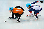 (L) Sjinkie Knegt of Netherlands being followed by (R) Sebastien Lepape of France during the Short Track Speed Skating as part of the 2014 Sochi Olympic Winter Games at Iceberg Skating Palace on February 10, 2014 in Sochi, Russia. Photo by Victor Fraile / Power Sport Images