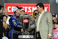 Nov. 14, 2008; Homestead, FL, USA; NASCAR Craftsman Truck Series driver Johnny Benson (left) is congratulated by NASCAR president Mike Helton after winning the 2008 championship following the Ford 200 at Homestead Miami Speedway. Mandatory Credit: Mark J. Rebilas-