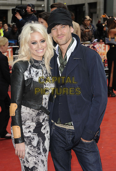 Kimberly Wyatt & Max Rogers.The 'Fast Girls' UK film premiere, Odeon West End cinema, Leicester Square, London, England..June 7th, 2012.half length black leather jacket white print dress beige tan yellow patches blue jeans denim hat couple   .CAP/CAN.©Can Nguyen/Capital Pictures.