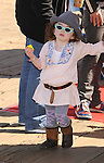 SANTA MONICA, CA. - March 14: Musician Shooter Jennings and daughter Alabama Gypsy Rose (L) attends the Make-A-Wish Foundation's Day of Fun hosted by Kevin & Steffiana James held at Santa Monica Pier on March 14, 2010 in Santa Monica, California.