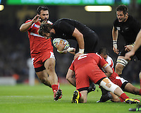 Samuel Whitelock of New Zealand is tackled by Shalva Mamukashvili of Georgia during Match 23 of the Rugby World Cup 2015 between New Zealand and Georgia - 02/10/2015 - Millennium Stadium, Cardiff<br /> Mandatory Credit: Rob Munro/Stewart Communications