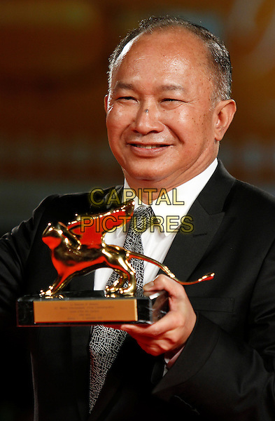JOHN WOO.Wins the Golden Lion award for Lifetime Achievement during the .67th Venice International Film Festival in.Venice, Italy, September 3rd, 2010.half length prize black suit tie smiling director white shirt .CAP/PE.©Peter Eden/Capital Pictures.