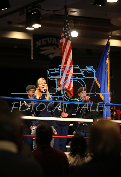 Cindy Lain performs the National Anthem at the start of the National Collegiate Boxing Association event in Reno, Nev. on Friday, Jan. 31, 2020. <br /> Photo by Cathleen Allison