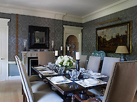 The main dining room was designed around Dolores Halpern's collection of Delft and 17th century Dutch paintings