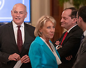 "White House Chief of Staff John Kelly, United States Secretary of Education Betsy DeVos, and US Secretary of Labor Alex Acosta prior to the arrival of US President Donald J. Trump who will sign an Executive Order establishing the National Council for the American Worker, which the Trump Administration calls ""an Interagency Council of Administration officials who will focus on crafting solutions to our country's urgent workforce issues"" in the East Room of the White House in Washington, DC on Thursday, July 19, 2018.<br /> Credit: Ron Sachs / CNP"