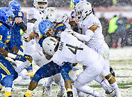 PHILADELPHIA, PA - DEC 9, 2017: Navy Midshipmen Quarterback back Malcolm Perry (10) is tackled by Army Black Knights defensive back Max Regan (4) during game between Army and Navy at Lincoln Financial Field Philadelphia, PA. Army defeated Navy 14-13 to win the Commander in Chief Cup. (Photo by Phil Peters/Media Images International)