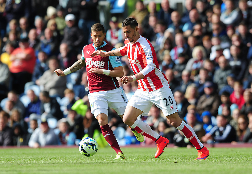 Burnley's Michael Kightly vies for possession with Stoke City's Geoff Cameron<br /> <br /> Photographer Chris Vaughan/CameraSport<br /> <br /> Football - Barclays Premiership - Burnley v Stoke City - Saturday 16th May 2015 - Turf Moor - Burnley<br /> <br /> &copy; CameraSport - 43 Linden Ave. Countesthorpe. Leicester. England. LE8 5PG - Tel: +44 (0) 116 277 4147 - admin@camerasport.com - www.camerasport.com