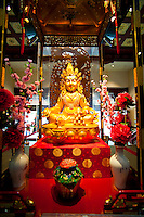 Gold Buddha at the Buddha Tooth Relic Museum in Chinatown, Singapore. The Buddha Tooth Relic Temple is an enormous Buddhist temple and museum based in Chinatown. As well as the famous Buddhas tooth perched on a stupa made of 320kg of gold, it also houses many other relics and is a popular stop for tourists visiting Singapore.