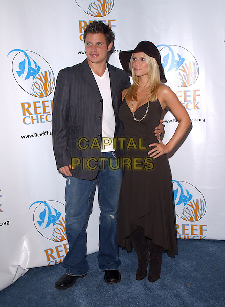 NICK LACHEY & JESSICA SIMPSON.The Reef Rescue 2004 Benefit for The Reef Check Foundation held at The Victorian in Santa Monica, California.September 30, 2004.full length, celebrity couple, marreid, hhusband, wife, black dress, hat, jeans, denim, jacket.www.capitalpictures.com.sales@capitalpictures.com.Copyright by Debbie VanStory