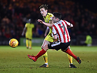Lincoln City's Tom Pett is fouled by  Cheltenham Town's William Boyle<br /> <br /> Photographer Andrew Vaughan/CameraSport<br /> <br /> The EFL Sky Bet League Two - Lincoln City v Cheltenham Town - Tuesday 13th February 2018 - Sincil Bank - Lincoln<br /> <br /> World Copyright &copy; 2018 CameraSport. All rights reserved. 43 Linden Ave. Countesthorpe. Leicester. England. LE8 5PG - Tel: +44 (0) 116 277 4147 - admin@camerasport.com - www.camerasport.com
