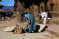 February 1975, Pokhara area, Nepal. Daily life. Street scene cleaning.