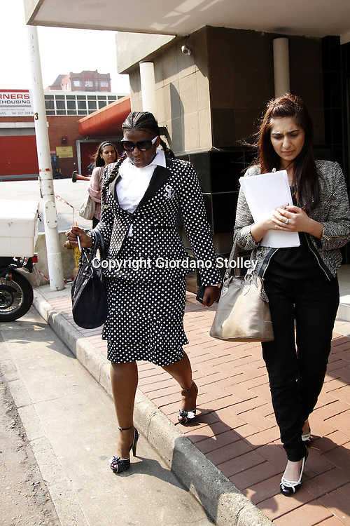 DURBAN - 13 September 2013 - Durban businesswoman Shawn Mpisane (left) leaves the Durban Commercial Crimes Court with an unknown assistant where she faces 53 charges of fraud, forgery and uttering of a forged document. She is accused of is accused of submitting forged documents to obtain Construction Industry Development Board gradings, which were then used to win five public works department tenders worth R140 million. Picture: Allied Picture Press/APP