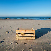 Wooden box on Baltic sea beach, Curonian Spit, Lithuania