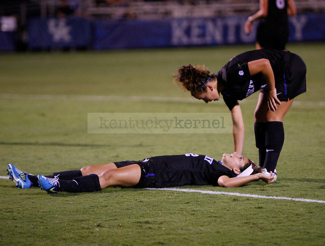 Junior forward Caitlin Landis helps freshman forward Cara Ledman up from the ground after missing a goal at Women's Soccer vs. UNC Greensboro at the UK Soccer Complex in Lexington, Ky., on Friday, August 31, 2012. Photo by Tessa Lighty | Staff