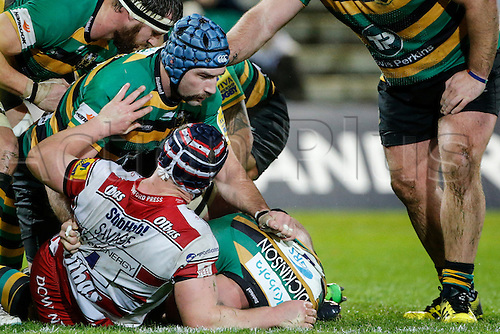 27.11.2015.  Franklin's Gardens, Northampton, England. Aviva Premiership. Northampton Saints versus Gloucester. Michael Paterson of Northampton Saints and Tom Savage of Gloucester Rugby in action.