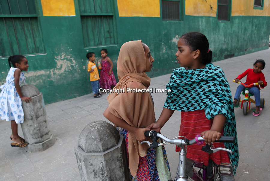 Two girls face off while playing in Stone Town in Zanzibar, Tanzania. Julia