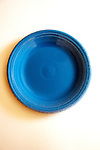 Bright blue plate on white background