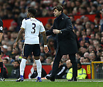 Mauricio Pochettino manager of Tottenham talks to Danny Rose of Tottenham during the English Premier League match at Old Trafford Stadium, Manchester. Picture date: December 11th, 2016. Pic Simon Bellis/Sportimage