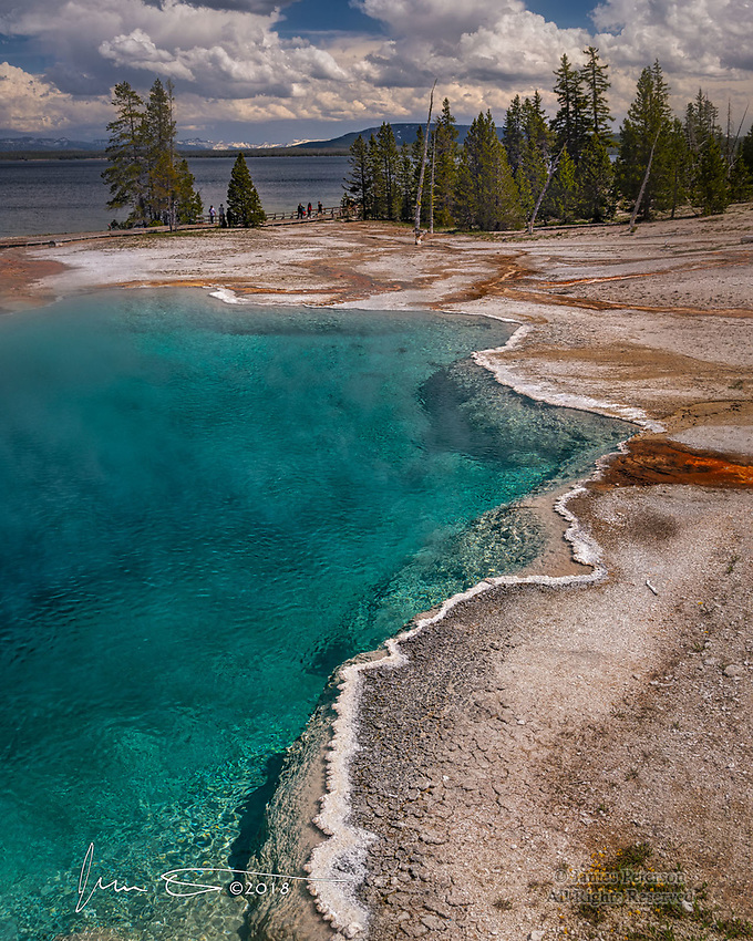 Black Pool, Yellowstone National Park ©2018 James D Peterson.  This steaming pond, on the edge of Yellowstone Lake (seen in the background) and rimmed with a white mineral crust, is part of the West Thumb Geyser Basin.